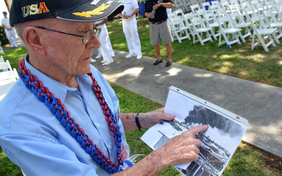 John F. Miniclier, who was a Marine private first class stationed on Sand Island during the Battle of Midway, points to the surveillance tower he was in during the Japanese attack on June 4, 1942. Miniclier was one of two veterans of the battle who attended the 75th anniversary ceremony held at Joint Base Pearl Harbor-Hickam June 2, 2017.