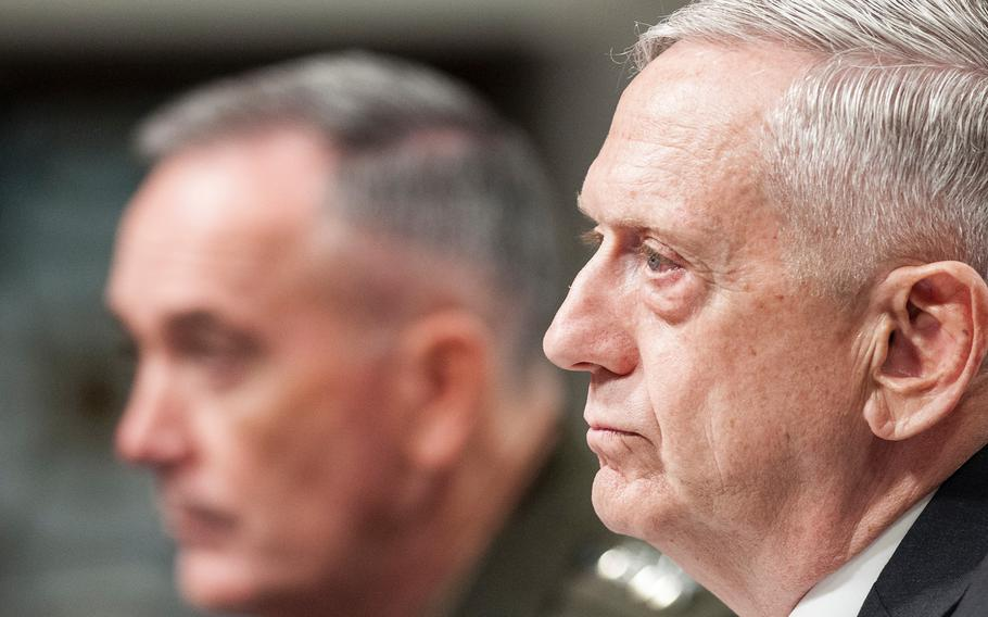 Defense Secretary Jim Mattis listens to pointed questions about Defense spending and U.S. military strategy in Afghanistan directed towards him by Sen. John McCain, during a Senate Armed Services Committee hearing on Capitol Hill in Washington, D.C., on Tuesday, June 13, 2017. At left is Chairman of the Joint Chiefs of Staff Gen. Joseph Dunford.