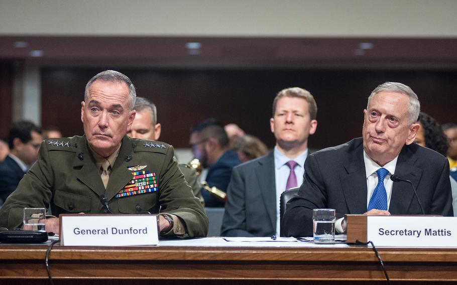 Defense Secretary Jim Mattis and Chairman of the Joint Chiefs of Staff Gen. Joseph Dunford attend a Senate Armed Services Committee hearing on Capitol Hill in Washington, D.C., on Tuesday, June 13, 2017. On Wednesday, Mattis told lawmakers that potentially thousands of additional troops could be deployed to Afghanistan.