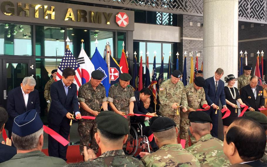 Army Lt. Gen. Thomas Vandal, fifth from right, and retired South Korean Gen. Paik Sun-yup, to his left, join other dignitaries for a ribbon-cutting ceremony to mark the opening of the new 8th Army headquarters at Camp Humphreys, South Korea, Tuesday, July 11, 2017.