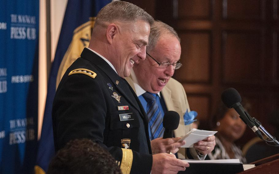 """Army Chief of Staff Gen. Mark Milley responds with laughter at the National Press Club in Washington on Thursday, July 27, 2017, when asked how he learned of President Donald Trump's tweets on transgender personnel in the military. """"I saw it on the news,"""" Milley said."""