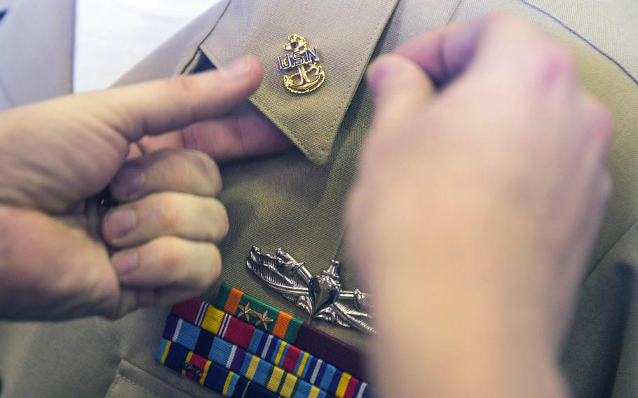 A chief hull technician receives his anchors during a chief petty officer pinning ceremony last year aboard the USS Green Bay.