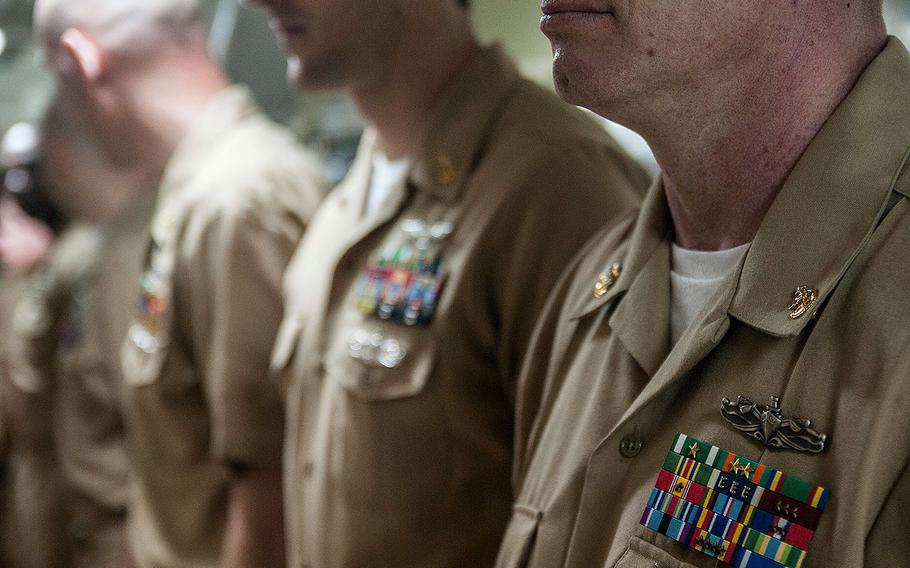 Newly-frocked Senior Chief Petty Officers stand in ranks during a pinning ceremony aboard the Nimitz-class aircraft carrier USS George Washington on May 29, 2015.