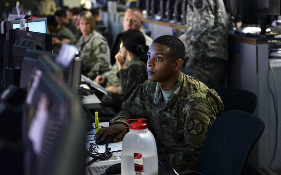 Sgt. Dennis Franklin monitors air space at the Hardened Theater Air Control Center, Osan Air Base, South Korea, during the first day of Ulchi Freedom Guardian drills in 2015.