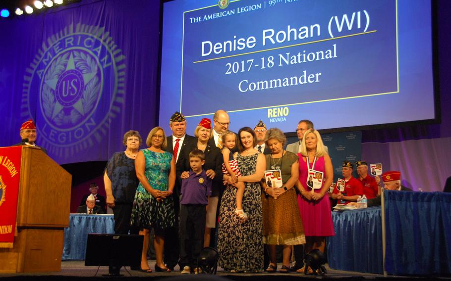 Denise Rohan surrounded by her family after being elected the new national commander of the American Legion on Thursday, Aug. 24, in Reno, Nev.