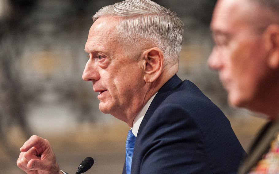 """Secretary of Defense Jim Mattis testifies at a Senate Armed Services Committee hearing Tuesday, Oct. 3, 2017, on Capitol Hill in Washington. Mattis pledged to the committee that """"the Department of Defense will be fully responsive to your requirement to be kept appraised of current and planned operations."""" In the foreground is Chairman of the Joints Chiefs of Staff, Gen. Joseph Dunford."""