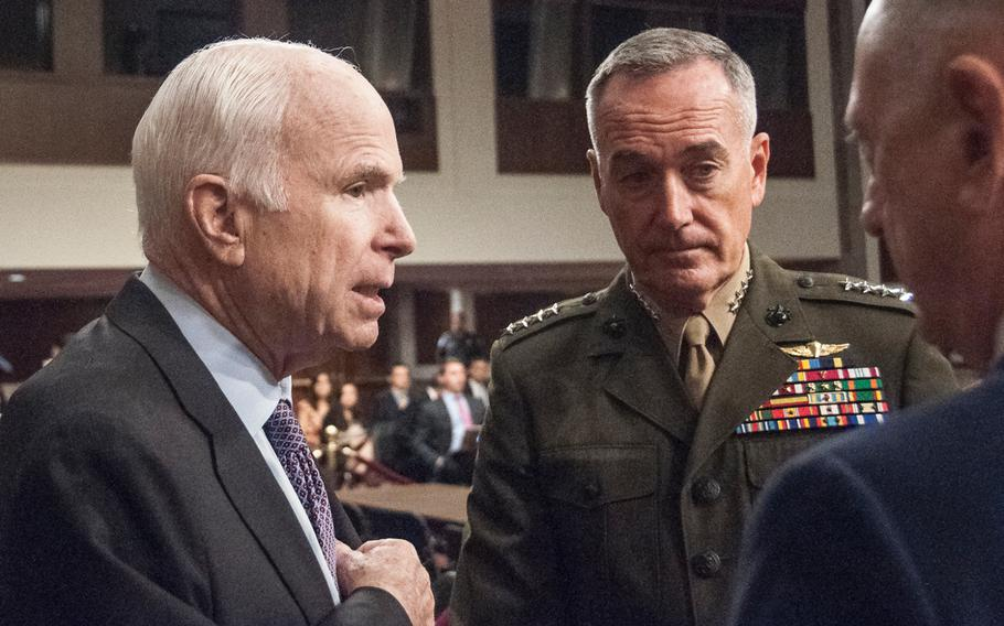 """Chairman of the Senate Armed Services Committee, Sen. John McCain, R-Ariz., speaks with Chairman of the Joint Chiefs of Staff Gen. Joseph Dunford and Secretary of Defense Jim Mattis prior to the start of a hearing Tuesday, Oct. 3, 2017, on Capitol Hill in Washington. During the hearing, McCain told the two military leaders, """"We want to be your partners. But this committee will not be a rubber stamp for any policy or president."""""""