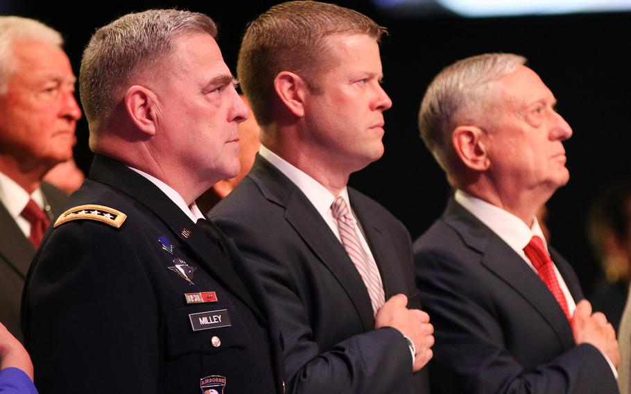 Army Chief of Staff Gen. Mark Milley, left, acting Secretary of the Army Ryan McCarthy and Defense Secretary Jim Mattis stand for the playing of the national anthem during the opening ceremony of the 2017 Association of the U.S. Army Meeting and Exposition held in Washington, D.C., on Oct. 9, 2017.