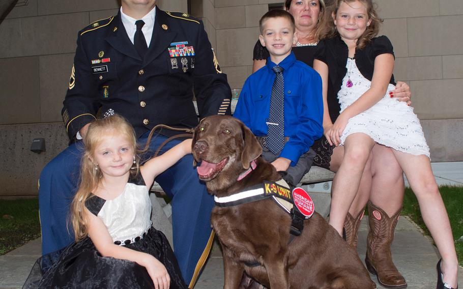 Army Sgt. First Class James Bennett poses with his family at the American Humane's K-9 Medal of Courage Awards on Capitol Hill on Oct. 11, 2017. From left to right is Madeline, military working dog Coffee, Tallon, Lindsay and Trinity.