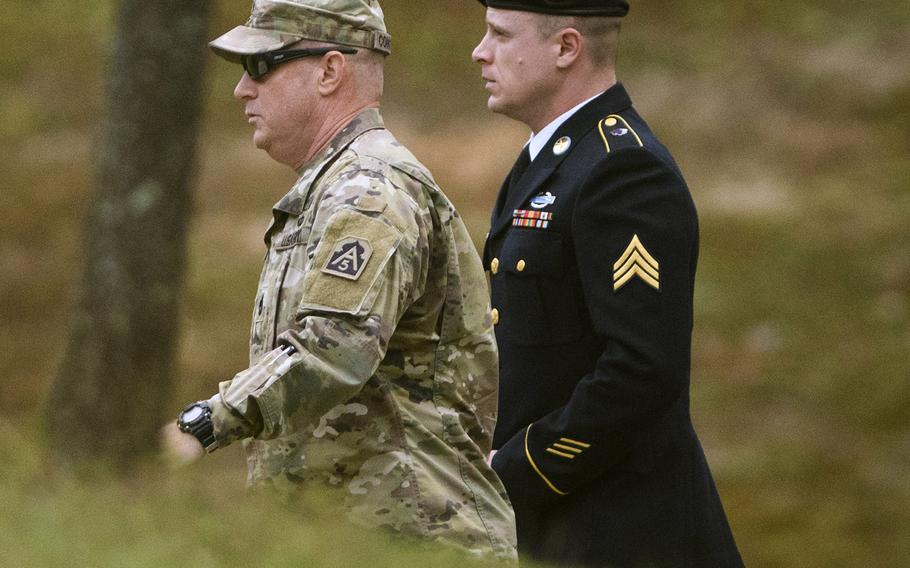 Army Sgt. Bowe Bergdahl, right, arrives for a motions hearing on Monday, Oct.16, 2017, on Fort Bragg.