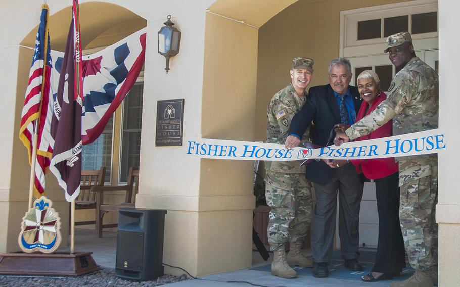 From left, Col. John A. Smyrski III, commander of William Beaumont Army Medical Center; John Ost III, director of the Army Fisher House Program; Alice Coleman, manager of WBAMC Fisher House; and Command Sgt. Maj. Donald George of WBAMC cut the ribbon to the newly renovated Fisher House on the WBAMC campus in El Paso, Texas, on May 12, 2017. The Fisher House provides military-affiliated families room and board at no cost throughout the duration of care for inpatient servicemembers, retirees or veterans at nearby health care facilities.