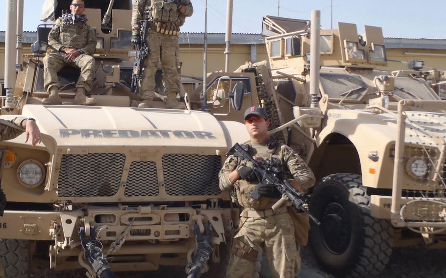 Former Army combat medic Dennis Magnasco, right, is shown in Afghanistan with other soldiers. Magnasco, who now works in the office of Rep. Seth Moulton, D-Mass., is putting out the call for gun reform along with other combat veterans.