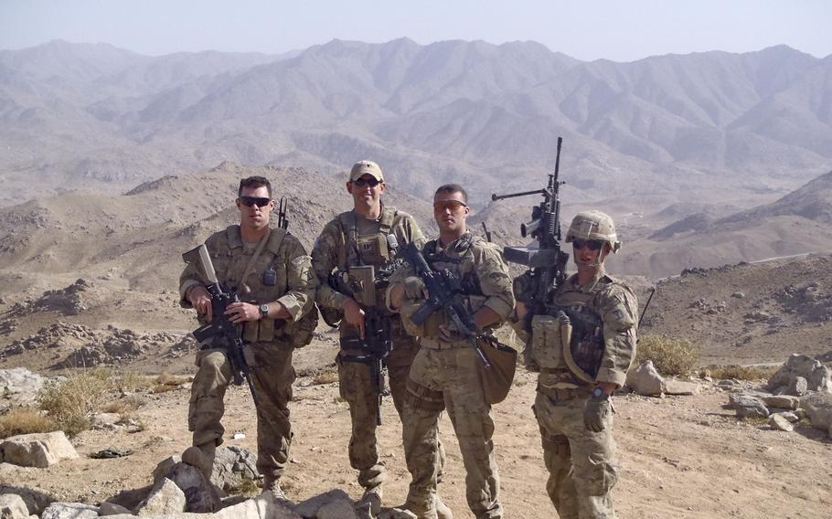 Former Army combat medic Dennis Magnasco, center right, is shown in Afghanistan with other soldiers. Magnasco, who now works in the office of Rep. Seth Moulton, D-Mass., is putting out the call for gun reform along with other combat veterans.