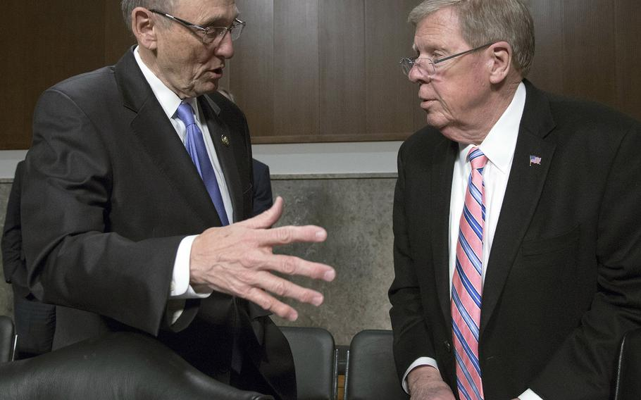 House Veterans' Affairs Committee chairman Phil Roe, R-Tenn., left, talks with his Senate counterpart, Johnny Isakson, R-Ga., before a joint hearing with several veterans' service organizations on Capitol Hill, March 6, 2018.