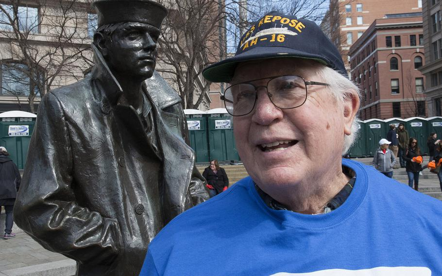 Navy veteran Richard Roberson, 71, of Hot Springs, Va., stands next to the Lone Sailor statue at the U.S. Navy Memorial in Washington, D.C., before the March for Our Lives on March 24, 2018.