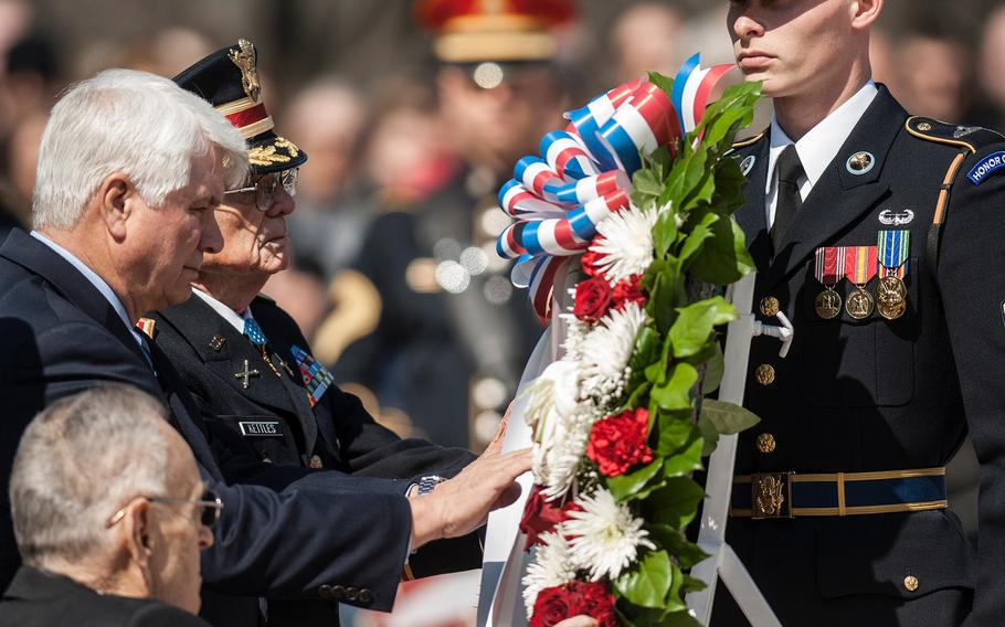 Medal of Honor recipients Ronald Rosser, foreground, James McCloughan, center, and Charles Kettles take part in a wreath laying ceremony at Arlington National Cemetery's Tomb of the Unknowns on Friday, March 23, 2018. The three were among more than two dozen MOH recipients who attended the commemorative event, which was part of the annual National Medal of Honor Day.