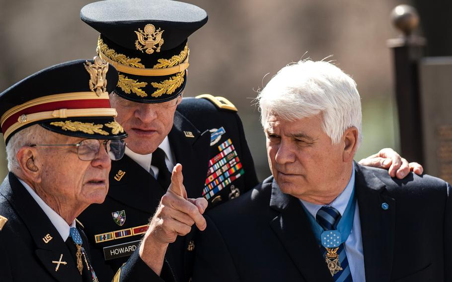 Maj. Gen. Michael Howard gives instructions to Medal of Honor recipients Charles Kettles, left, and James McCloughan before the start of a wreath laying ceremony at Arlington National Cemetery's Tomb of the Unknowns on Friday, March 23, 2018. Kettles and McCloughan were among more than two dozen MOH recipients who attended the commemorative event, which was part of the annual National Medal of Honor Day.