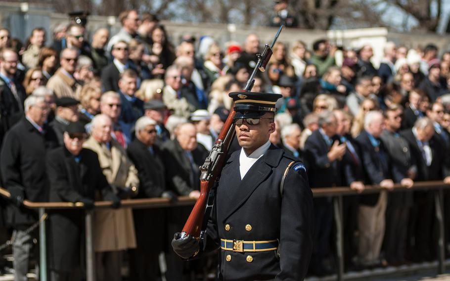 A U.S. soldier performs his sentinel duties while guarding the Tomb of the Unknowns at Arlington National Cemetery in northern Virginia on Friday, March 23, 2018.