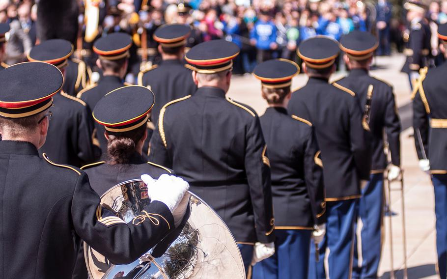 """Members of the United States Army Band, """"Pershing's Own,"""" take part in a special wreath-laying ceremony at Arlington National Cemetery's Tomb of the Unknowns on Friday, March 23, 2018."""