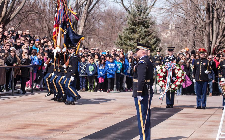 A color guard present the colors to start off a special wreath-laying ceremony at Arlington National Cemetery's Tomb of the Unknowns on Friday, March 23, 2018. More than two dozen Medal of Honor recipients observed the event.