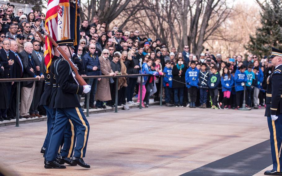 A color guard presents the colors to start off a special wreath-laying ceremony at Arlington National Cemetery's Tomb of the Unknowns on Friday, March 23, 2018. More than two dozen Medal of Honor recipients observed the event.