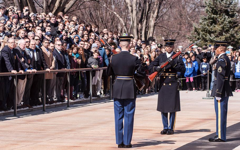 Ceremonial Army guards perform a change-of-the-guard routine before the start of a special wreath-laying ceremony at Arlington National Cemetery's Tomb of the Unknowns on Friday, March 23, 2018. More than two dozen Medal of Honor recipients, taking part in events to commemorate National Medal of Honor Day, were among a crowd of onlookers observing the ritual.