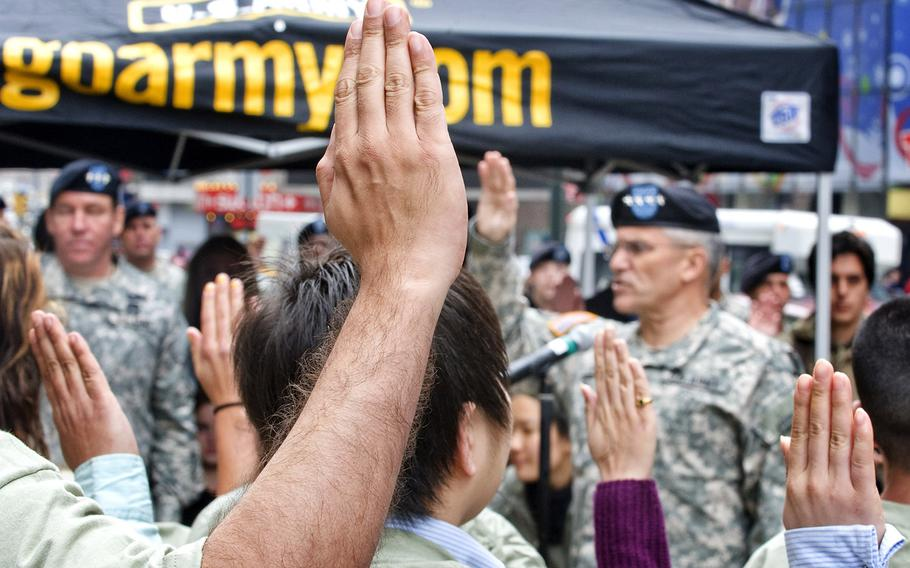 Army Gen. George W. Casey Jr., then the Army's chief of staff, administers the oath of enlistment to 26 recruits in New York City. The photo, taken in 2009, includes 16 recruits with the Military Accessions Vital to National Interest program, which enabled over 10,000 foreign-born people with special language or medical skills to enlist in the military.