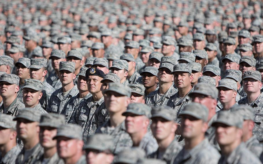 Soldiers and airmen from the Arizona National Guard assemble in a mass formation during the Arizona National Guard Muster on Dec. 7, 2017, in Tempe, Ariz.