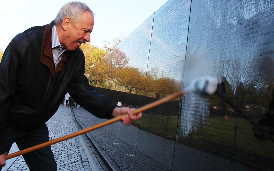 Former Vietnam Veterans Memorial Fund leader Jan Scruggs joins more than 40 volunteers in cleaning the Vietnam Wall in Washington, D.C., Saturday, April 21, 2018. It was Scruggs' first visit to the memorial he helped build since spending 28 days in a coma last year due to endocarditis.