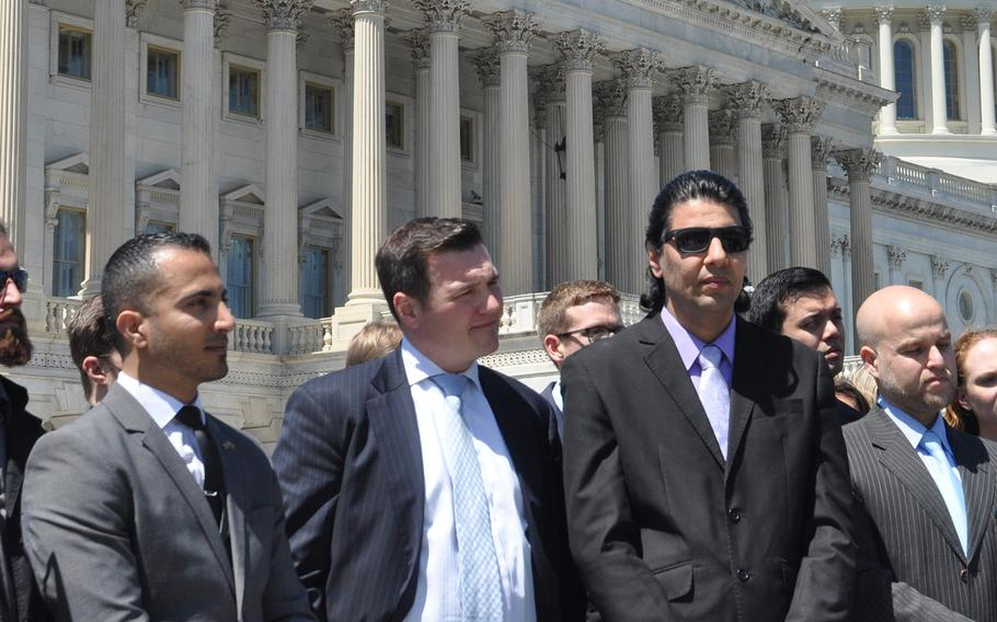 Former Iraqi interpreter Maytham Alshadood, left, No One Left Behind CEO Matt Zeller, center, and former Afghan interpreter Janis Shinwari stand outside the U.S. Capitol on Thursday, April 26, 2018, where they joined with dozens of veterans calling on Congress to keep the special immigrant visa program going.