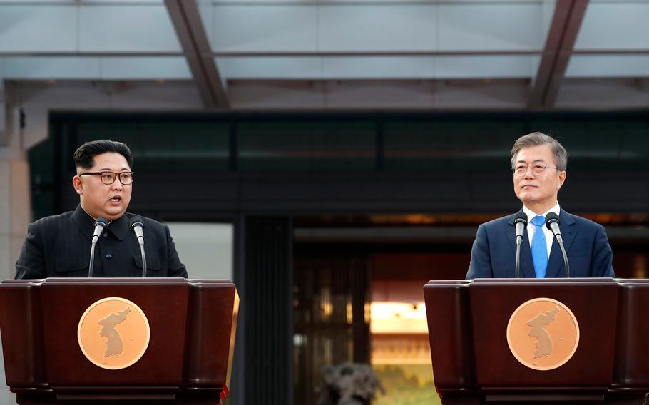 North Korean leader Kim Jong Un speaks alongside South Korean President Moon Jae-in during a meeting at the Inter-Korean Summit on Friday, April 27, 2018.