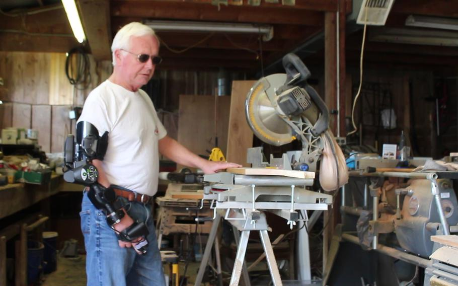 Maryland Army National Guard veteran Dave Wherry assembles his MyoPro arm brace. Wherry suffered a stroke in 2011 which left him paralyzed on the right side of his body. With the help of his MyoPro, created by robotics company by Myomo Incorporated, he has regained functionality in his arm.