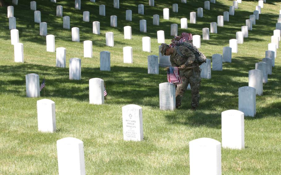 The U.S. Army's 3rd Infantry Regiment, better known as The Old Guard, march on to Arlington National Cemetery on May 24, 2018, to place flags at graves throughout the cemetery ahead of Memorial Day weekend.