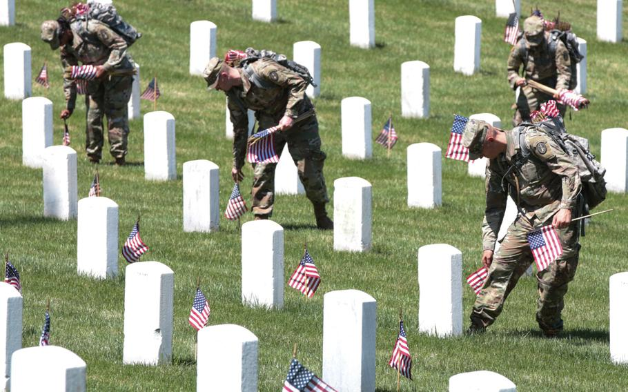 The U.S. Army's 3rd Infantry Regiment placed more than 200,000 flags on May 24, 2018, at gravesites throughout Arlington National Cemetery ahead of Memorial Day weekend.