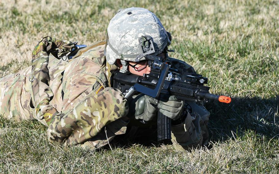 Army Sgt. Michael Zamora assumes a prone fighting position using a prototype Third Arm exoskeleton device during testing at Aberdeen Proving Ground, Maryland, March 14, 2018.