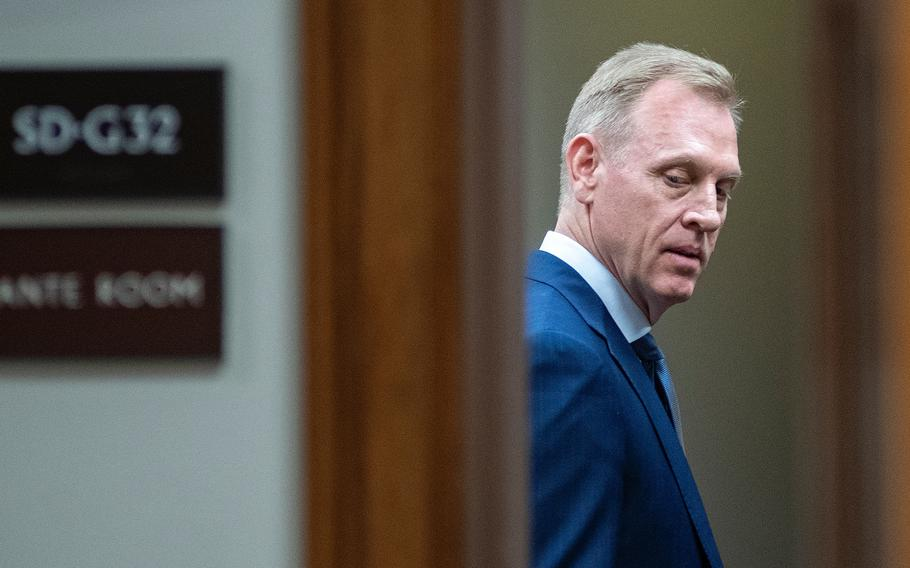 Acting Secretary of Defense Patrick Shanahan looks over his shoulder as he arrives for a Senate Armed Services Committee hearing on Capitol Hill in Washington on Thursday, March 14, 2019.