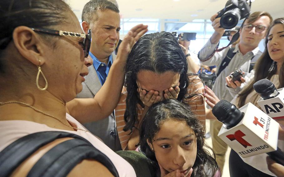 Alejandra Juarez, 38, left, says goodbye to her children, Pamela and Estela at the Orlando International Airport on Friday, Aug. 3, 2018 in Orlando, Fla.