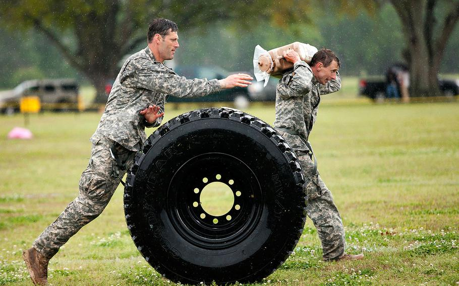 Master Sgt. Christopher Nelms and Sgt. Maj. Walter Zajkowski compete against each other in the sling load recovery during the second to last event of the 30th Annual Best Ranger Competition, April 14, 2013 at Fort Benning.