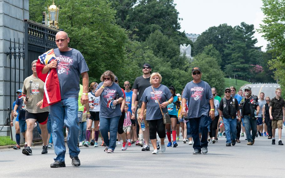 Gold Star families, servicemembers and supporters walk the final mile of the Run for the Fallen at Arlington National Cemetery in Virginia on Aug. 5, 2018. The Run for the Fallen traversed 19 states over 5 months, over a route that covered almost 6,000 miles. Each mile honored fallen American servicemembers.
