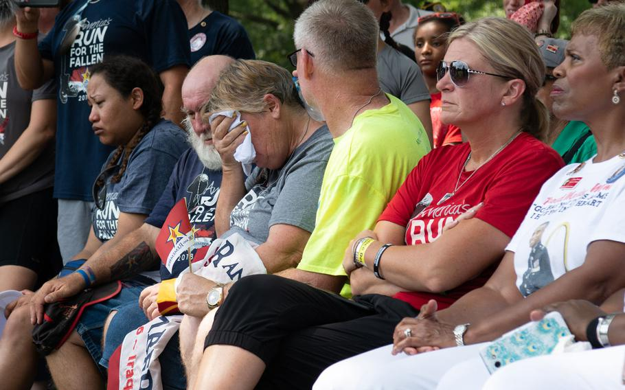 Gold Star families react to remarks offered during the closing ceremony of the Run for the Fallen in Arlington National Cemetery on Aug. 5, 2018. The Run for the Fallen traversed 19 states over five months, over a route that covered almost 6,000 miles. Each mile honored deceased American servicemembers.