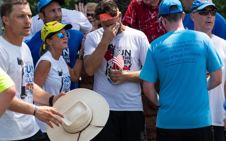 The team of runners reacts to hearing the final names read aloud at the end of their journey to Arlington National Cemetery as part of the Run for the Fallen, on Aug. 5, 2018. The Run for the Fallen traversed 19 states over five months, over a route that covered almost 6,000 miles. Each mile honored deceased American servicemembers.