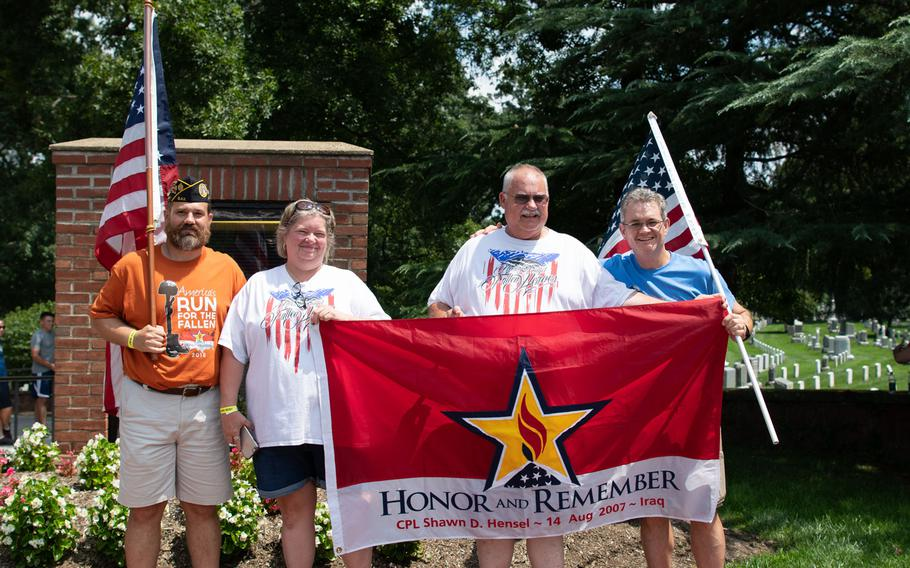 The family of Cpl. Shawn D. Hensel, along with supporters, cheer on the final leg of the Run for the Fallen at Arlington National Cemetery on Aug. 5, 2018. The Run for the Fallen traversed 19 states over five months, over a route that covered almost 6,000 miles. Each mile honored deceased American servicemembers.