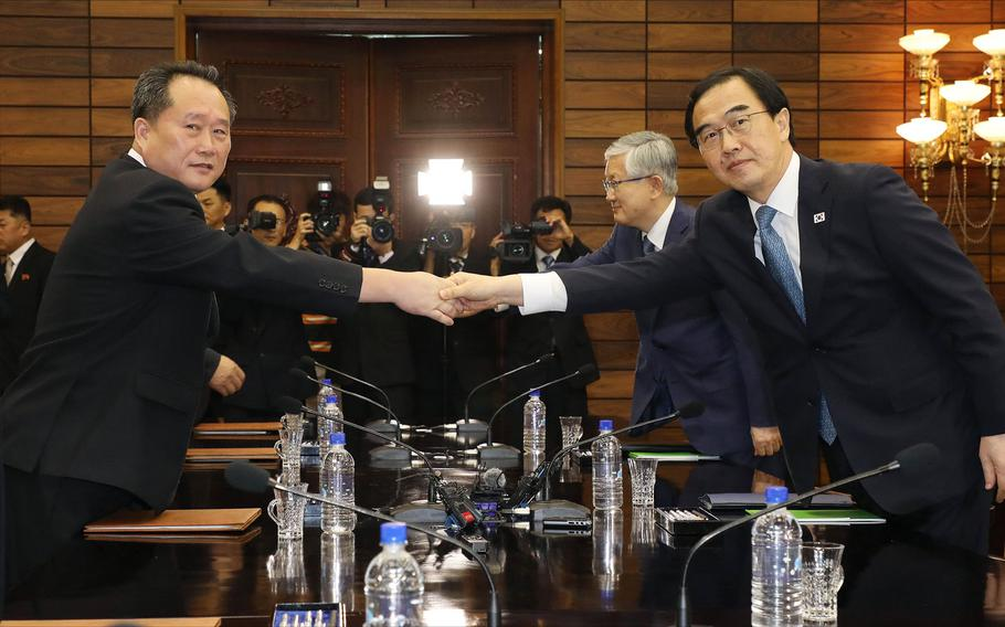 South Korean Unification Minister Cho Myoung-gyon, right, shakes hands with his North Korean counterpart Ri Son Gwon during their meeting at the northern side of Panmunjom in the Demilitarized Zone, North Korea, Monday, Aug. 13, 2018. Senior officials from the rival Koreas met Monday to set a date and venue for a third summit between South Korean President Moon Jae-in and North Korean leader Kim Jong Un, part of an effort to breathe new life into resolving the nuclear standoff between Washington and Pyongyang.