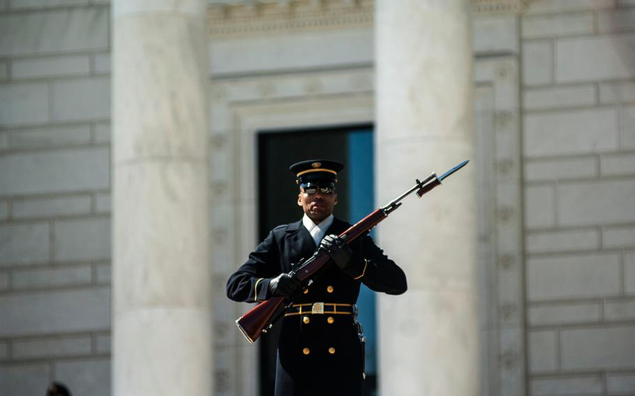 A soldier stands guard at Arlington National Cemetery's Tomb of the Unknowns on March 23, 2018. Visitors and employees at the cemetery were evacuated Wednesday, Aug. 22, 2018, because of a bomb threat.