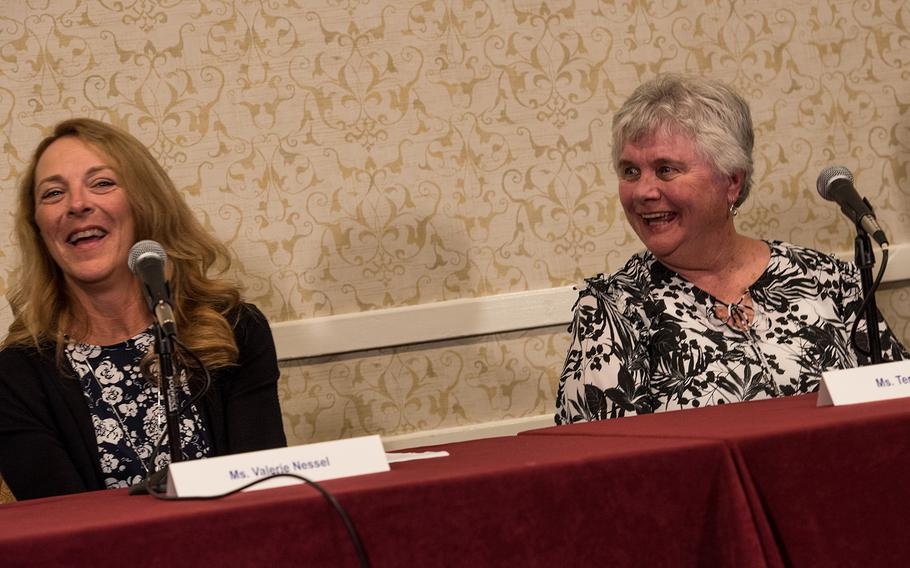 Terry Chapman, right, the mother of fallen Air Force Tech. Sgt. John Chapman, shares a laugh with Valerie Nessel, Chapman's widow, on Aug. 21, 2018 during a press conference in Arlington, Va. Chapman, who died in Afghanistan in 2002, was on Wednesday set to be awarded the Medal of Honor for his actions before his death.