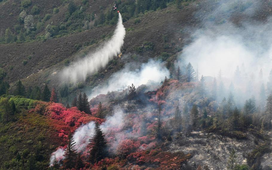 Pink fire retardant dropped from a National Guard aircraft into the Mendocino Complex in California fire is seen on Aug. 7, 2018.