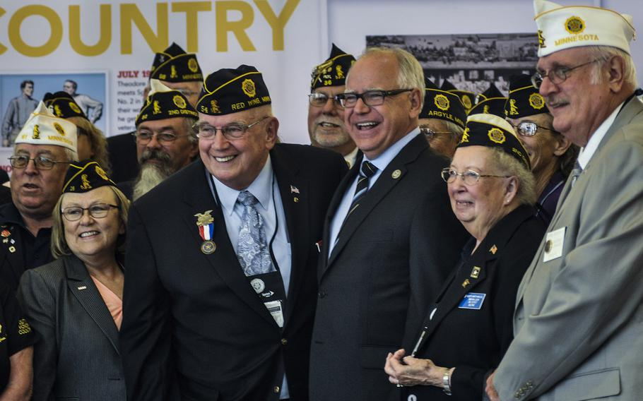 Rep. Tim Walz, D-Minn., ranking member of the House Veterans' Affairs Committee, poses with veterans at the American Legion's national convention in Minneapolis, Minn., Wednesday, Aug. 29, 2018.