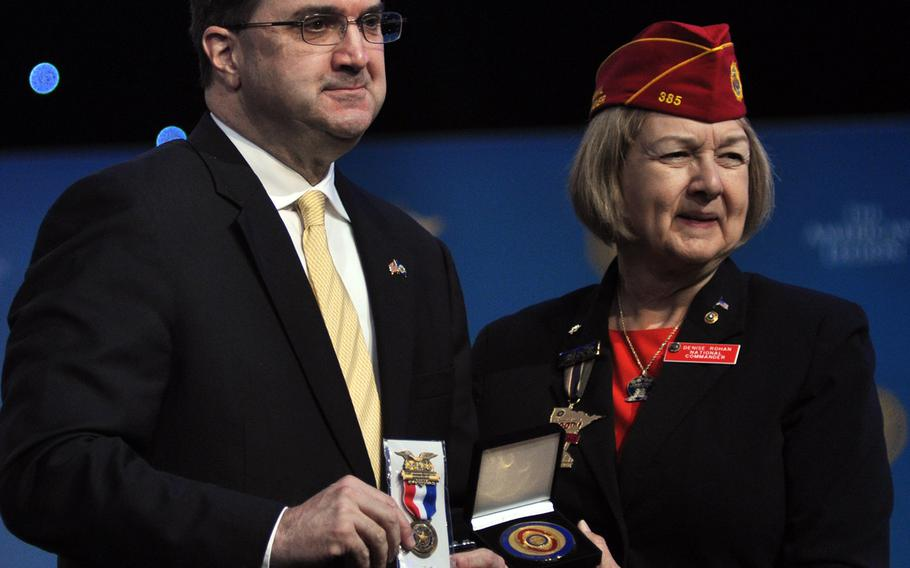 American Legion National Commander Denise Rohan presents parting gifts to Department of Veterans Affairs Secretary Robert Wilkie following his address to the organization's national convention Wednesday, Aug. 29 in Minneapolis, Minn. Wilkie underscored the importance of the Legion's advocacy in the group's 100-year history and reassured members the Legion still maintained influence at the VA.