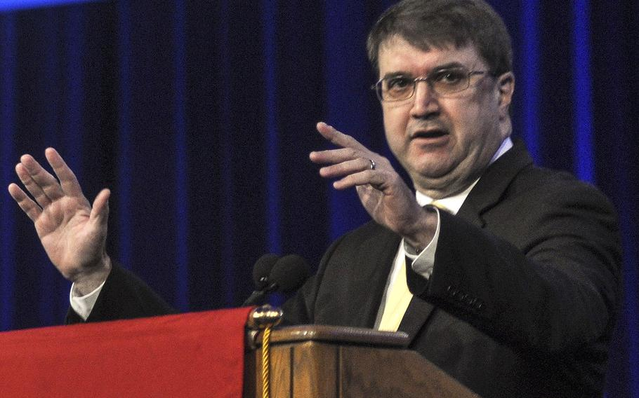 """Department of Veterans Affairs Secretary Robert Wilkie gestures as he addresses thousands of members gathered for the American Legion national convention in Minneapolis, Minn., on Wednesday, Aug. 29. Wilkie, who took the position in July, reassured the group that it still had a """"seat at the table"""" as an adviser on VA matters."""