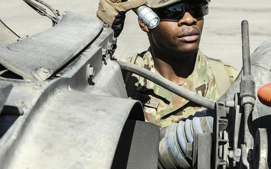 At the Texas-Mexico border-Eagle Pass point of entry, Pvt. DeVante Williams, of the 1st Battalion, 124th Calvary Regiment, of the Texas Army National Guard, takes part in Operation Guardian Support by assisting Customs and Border Protection agents with a search of an 18-wheeler's cab and load on July 11, 2018.